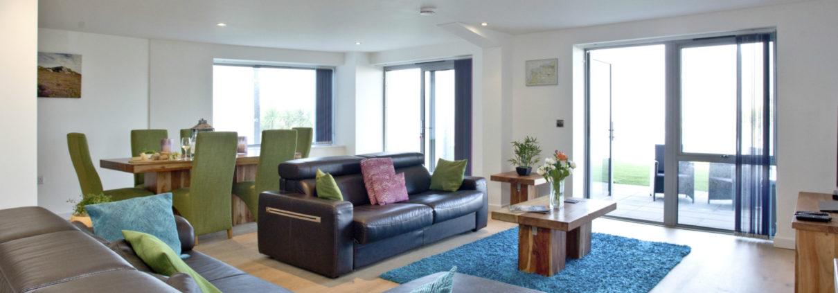 Apartment 2 Crantock Bay living room 1210x423 - Holiday Apartment 2