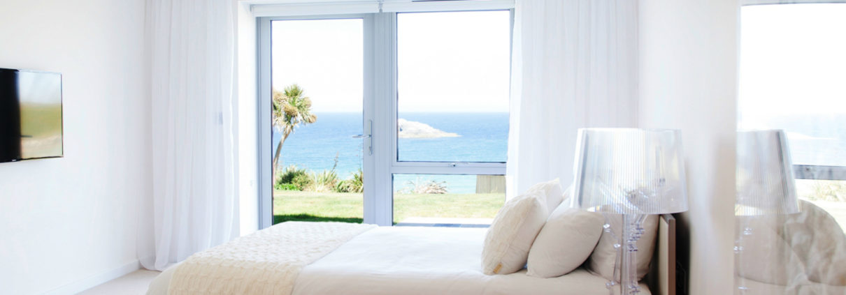 Apartment 3 Crantock Bay master bedroom 1210x423 - Holiday Apartment 3